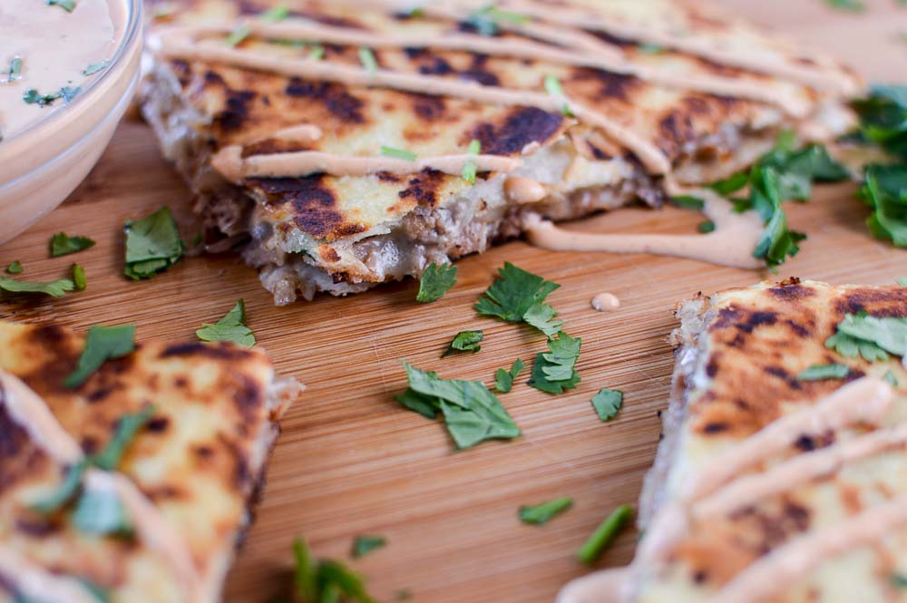 Closeup of the amazingly delicious Kalua Pig Pulled Pork Quesadilla with Chipotle Cream Sauce