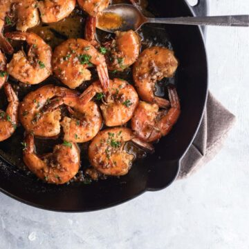 Overhead shot of New Orleans BBQ Shrimp and Sauce in Frying Pan.