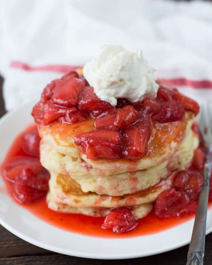 Closeup of the delicious Fluffy Champagne Strawberry Glazed Pancakes served in a white plate