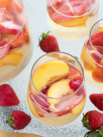 This easy Sparkling Peach and Strawberry Sangria was a hit at our cook out this weekend!
