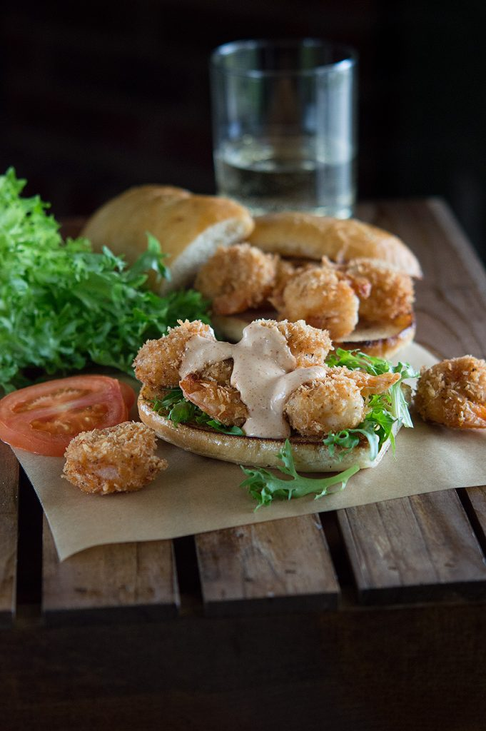 Delicious sauce running over Cajun Panko Crusted Shrimp Po Boys