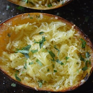 Overhead on the delicious Garlic Parmesan Spaghetti Squash in a metal tray