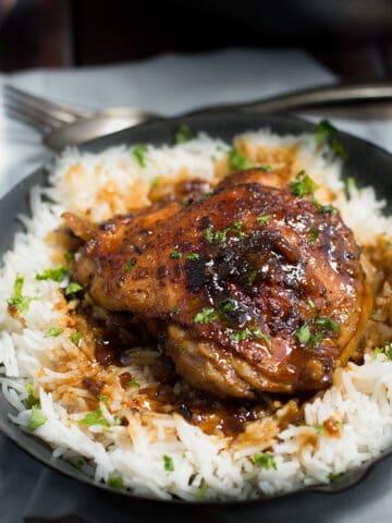 Crispy One Pan Honey Garlic Ethiopian Berbere Chicken Thighs served with rice