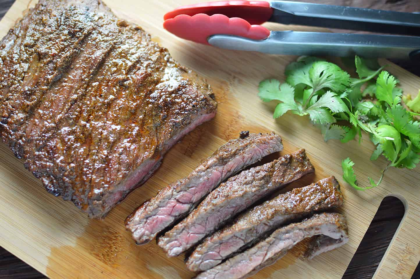 Overhead on the juicy Citrus Marinated Skirt Steaks with a bit of parsley on the side