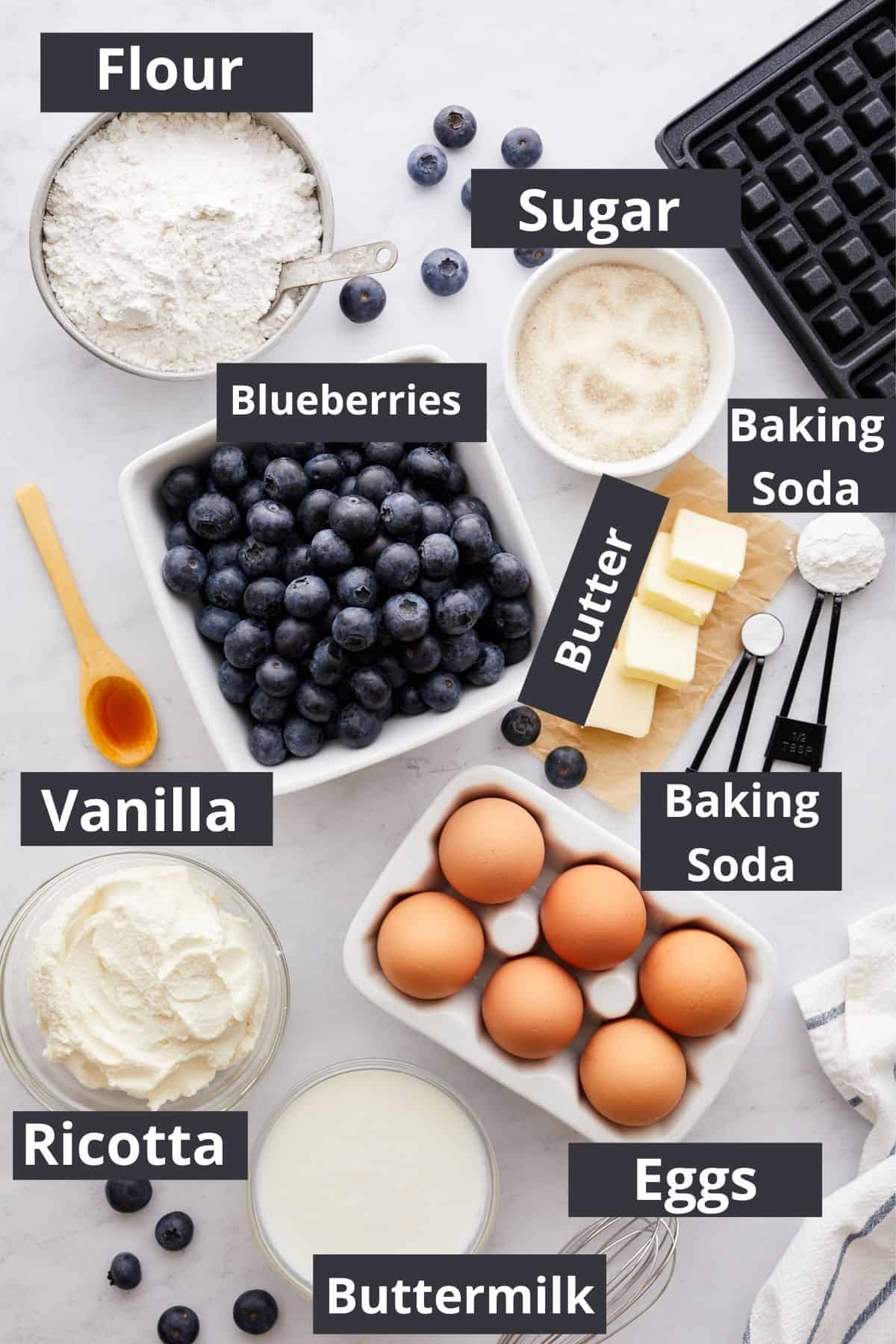 Blueberry Ricotta Waffles ingredients neatly labeled and presented on a table