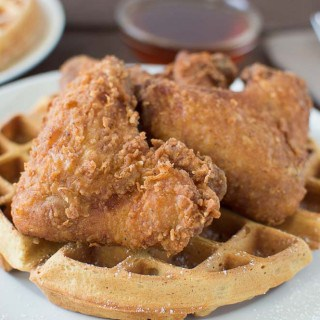 Closeup on the delicious Buttermilk Peach Waffles with Buttermilk Fried Chicken