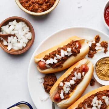 Overhead on the delicious and easy Homemade Hot Dog Chili served in hot dogs on a white plate