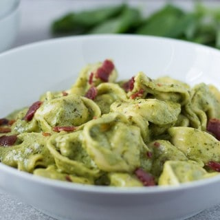 Quick Creamy Pesto Sauce on top of the dumplings looking extra delicious
