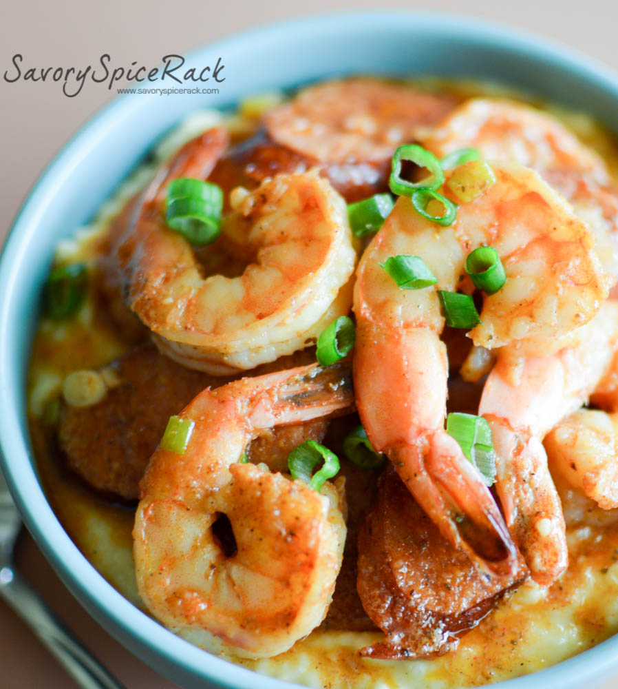 Gigantic shrimp on top of the cajun shrimp and grits looking absolutely fantastic