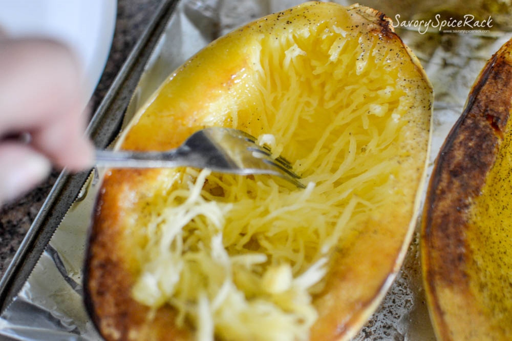 Scraping the spaghetti squash out of the shell with a fork