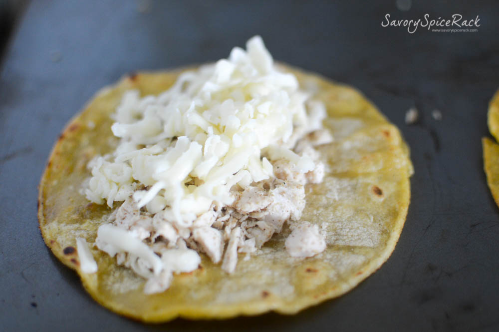 Piling your cheese and chicken on to the crunchy tortillas