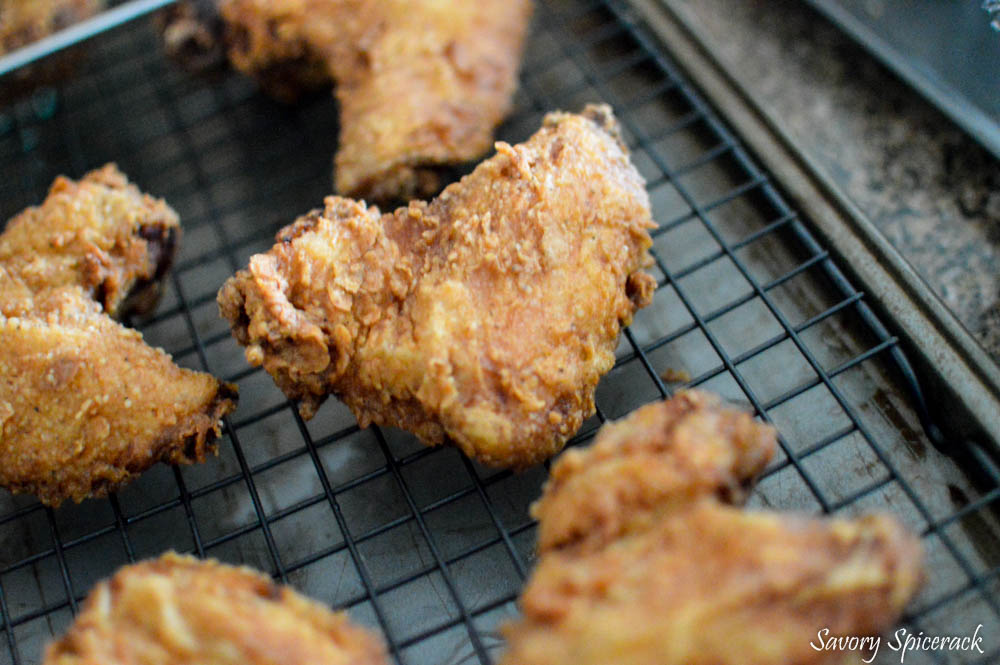 Buttermilk Fried Chicken placed on a cooking rack to rest