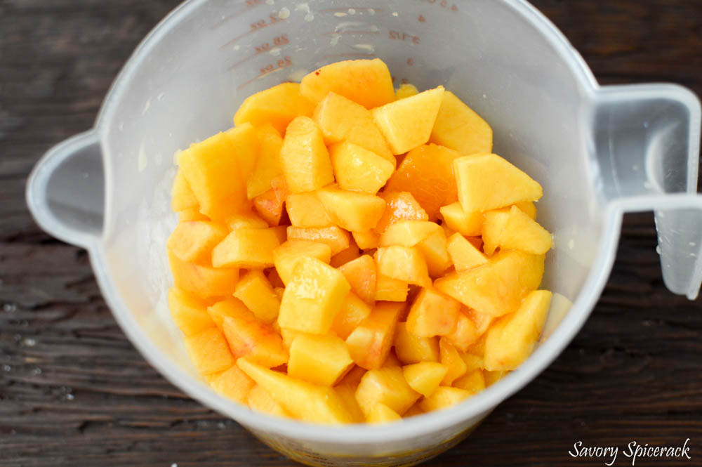Diced up peaches in a vessel