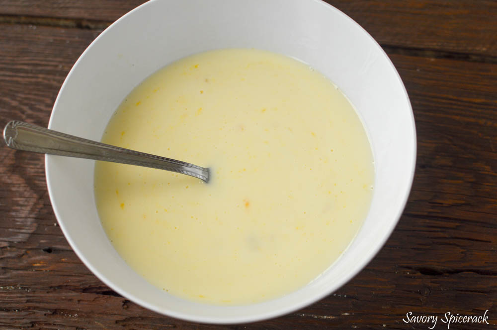 Mixing all wet ingredients together in a big white bowl