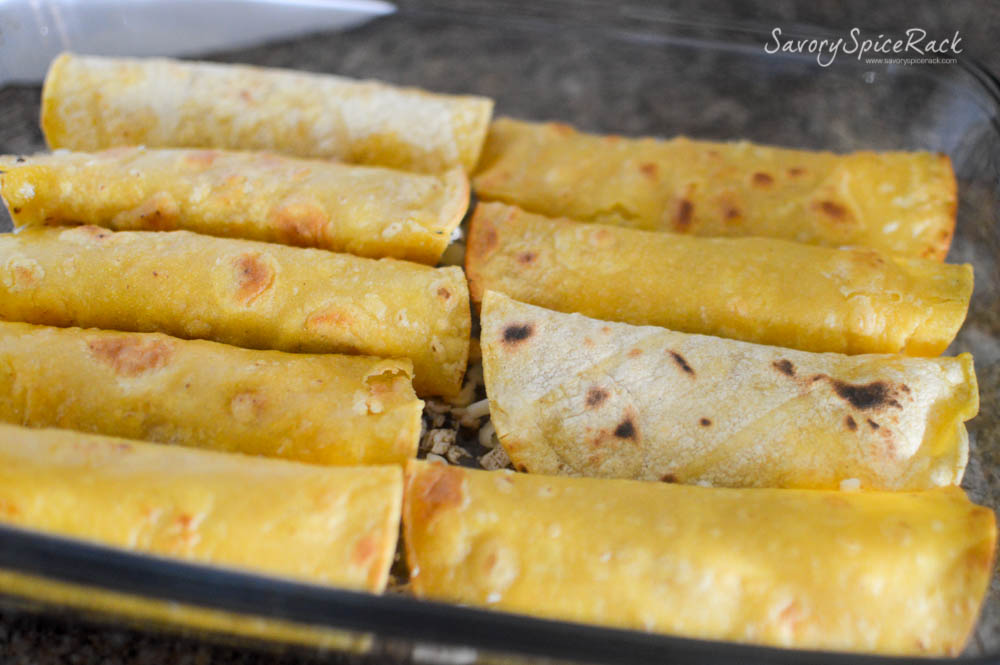 Rolling White Sauce Enchiladas and layering on the goodness...