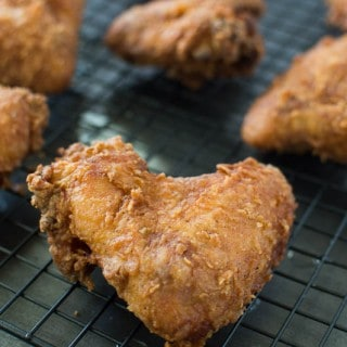 Buttermilk Fried Chicken on an oven rack looking extra crispy and delicious