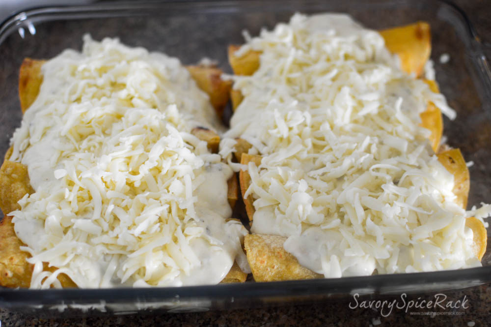 Enchiladas with White Sauce and cheese on top